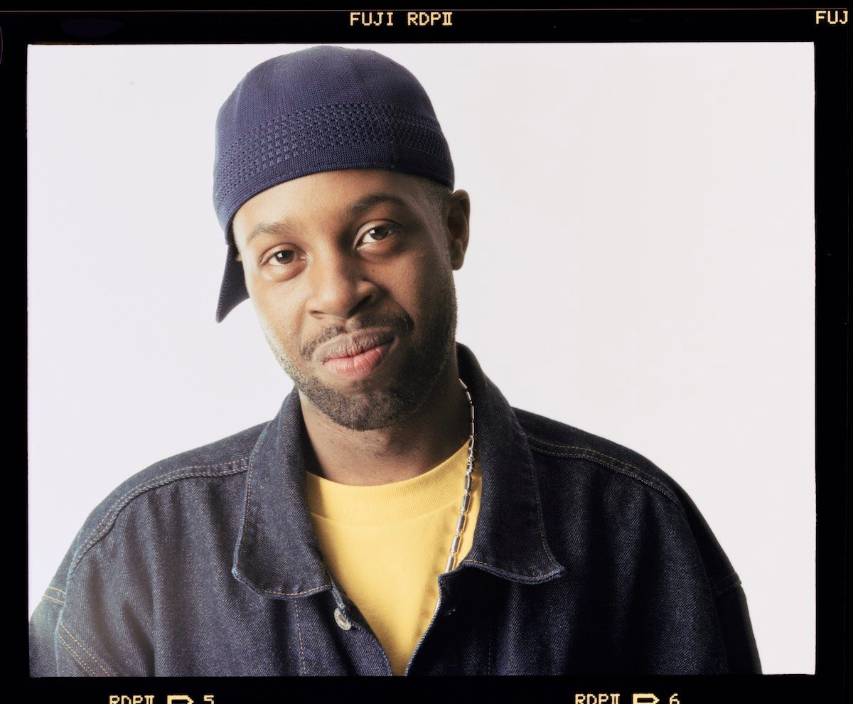 J Dilla hat and yellow shirt